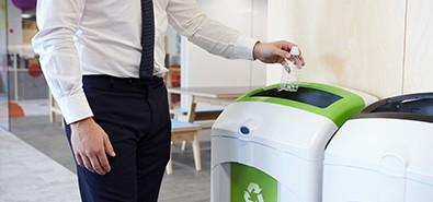 office worker recycling plastic bottle