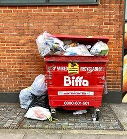 bin overflowing on street