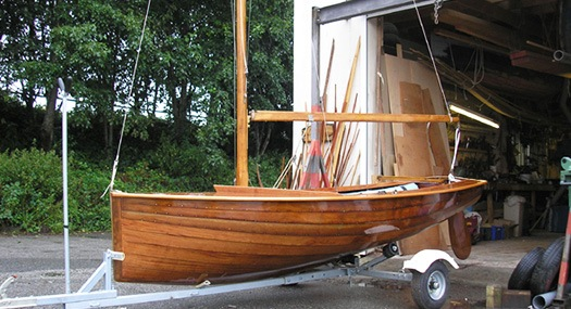 New Wooden Boat Builds Cornwall - finished sailing yacht going out to sea