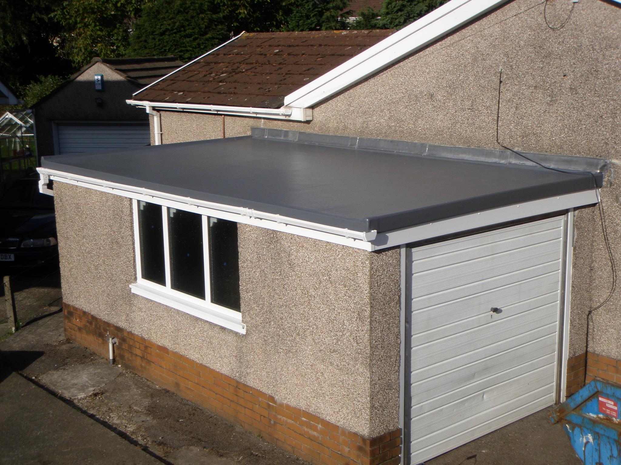 Garage fibreglass flat roofing installation.
