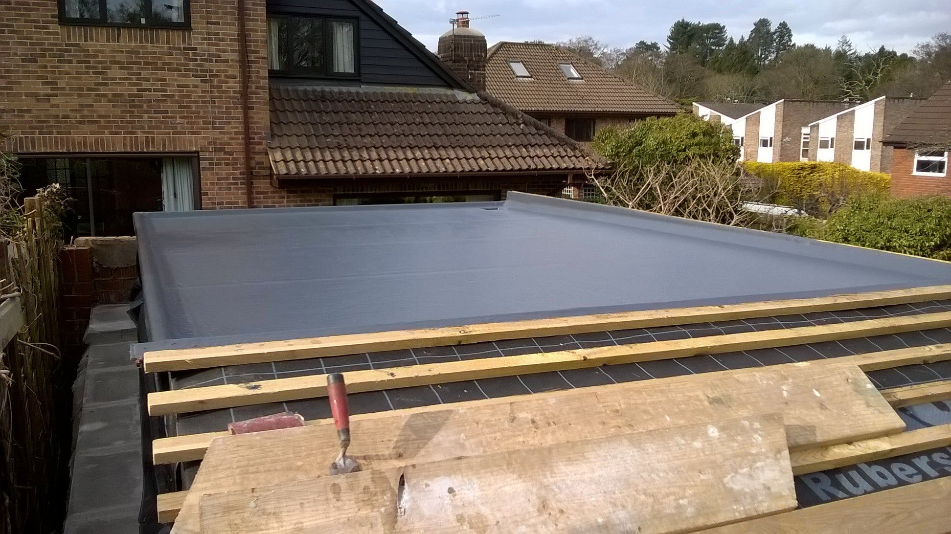 Grey fibreglass flat roof completed.
