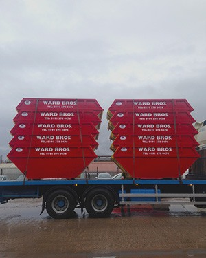 skips stacked up ready for hire