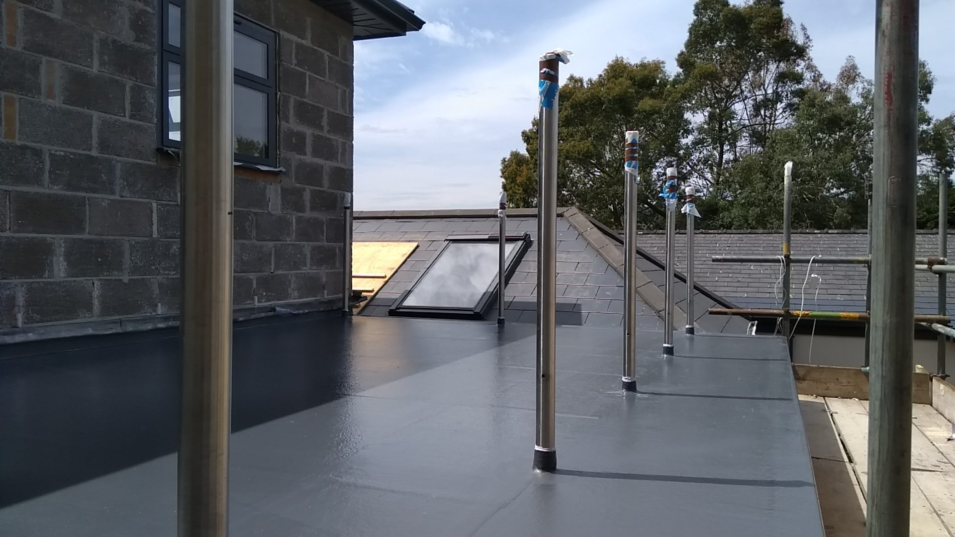 Grey Fibreglass flat roof in Chepstow with posts.