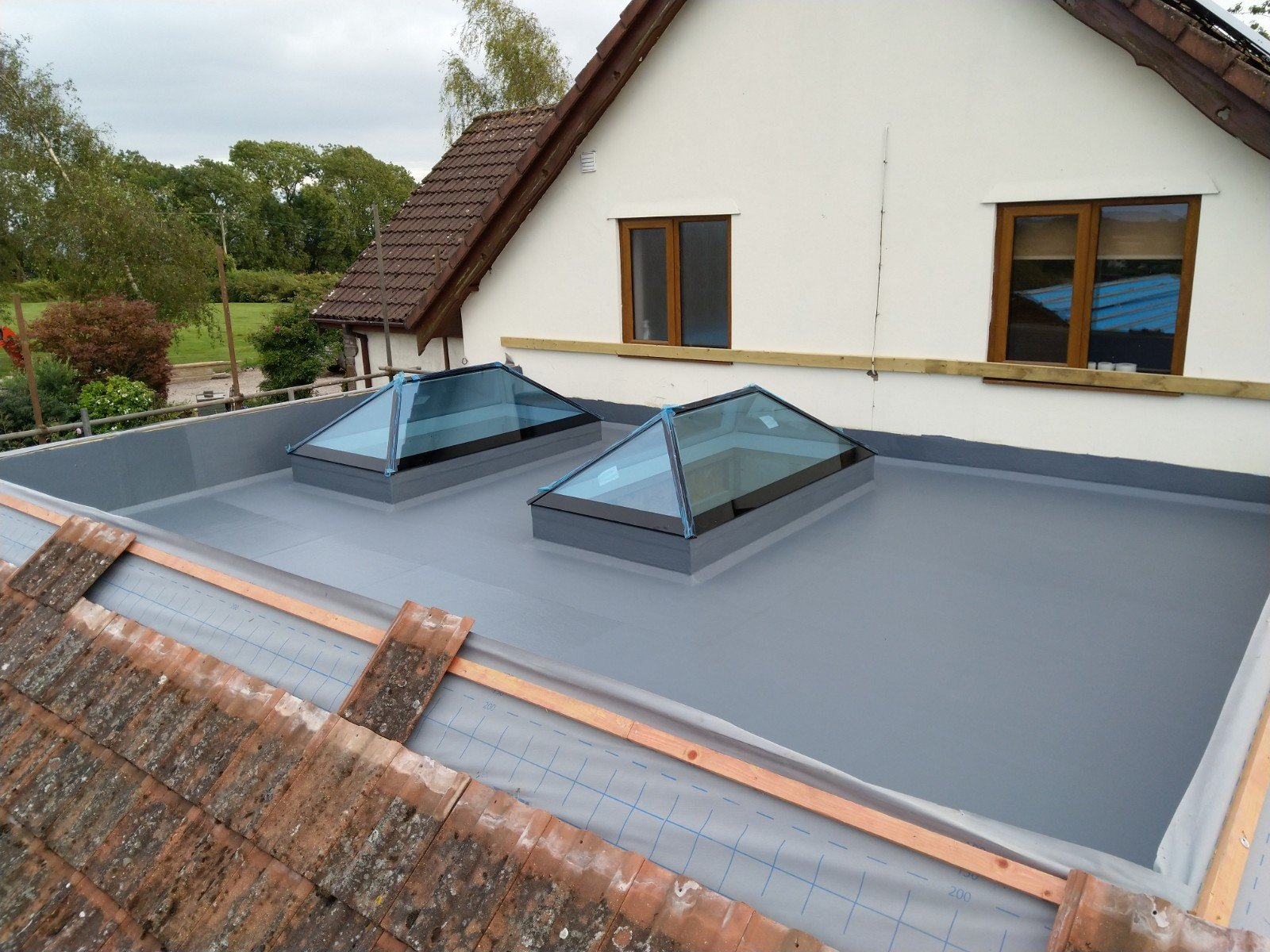 Fibreglass flat roof in Chepstow with 2 lantern skylights.