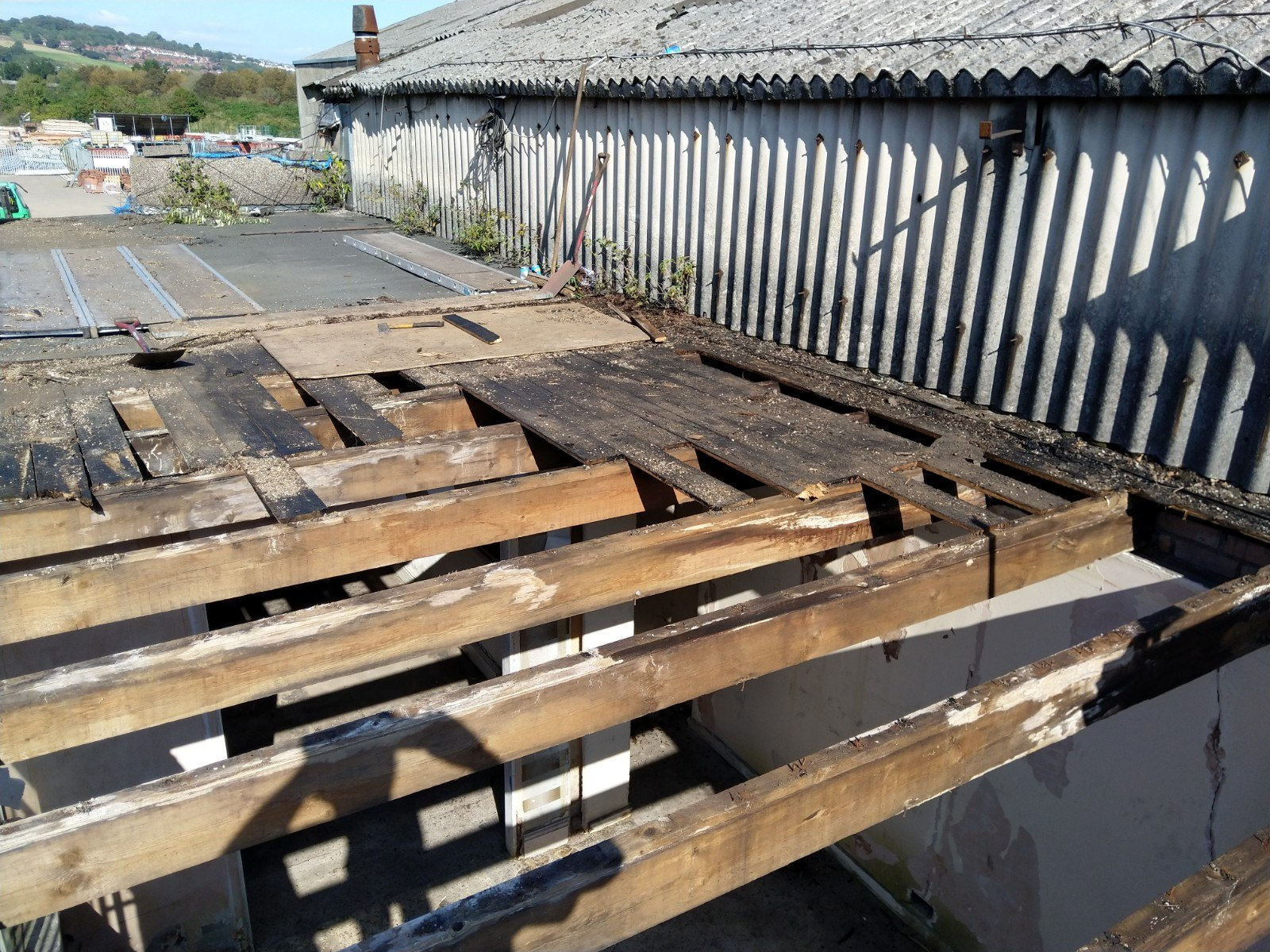 A rotten flat roof in Newport with collapsing joists.