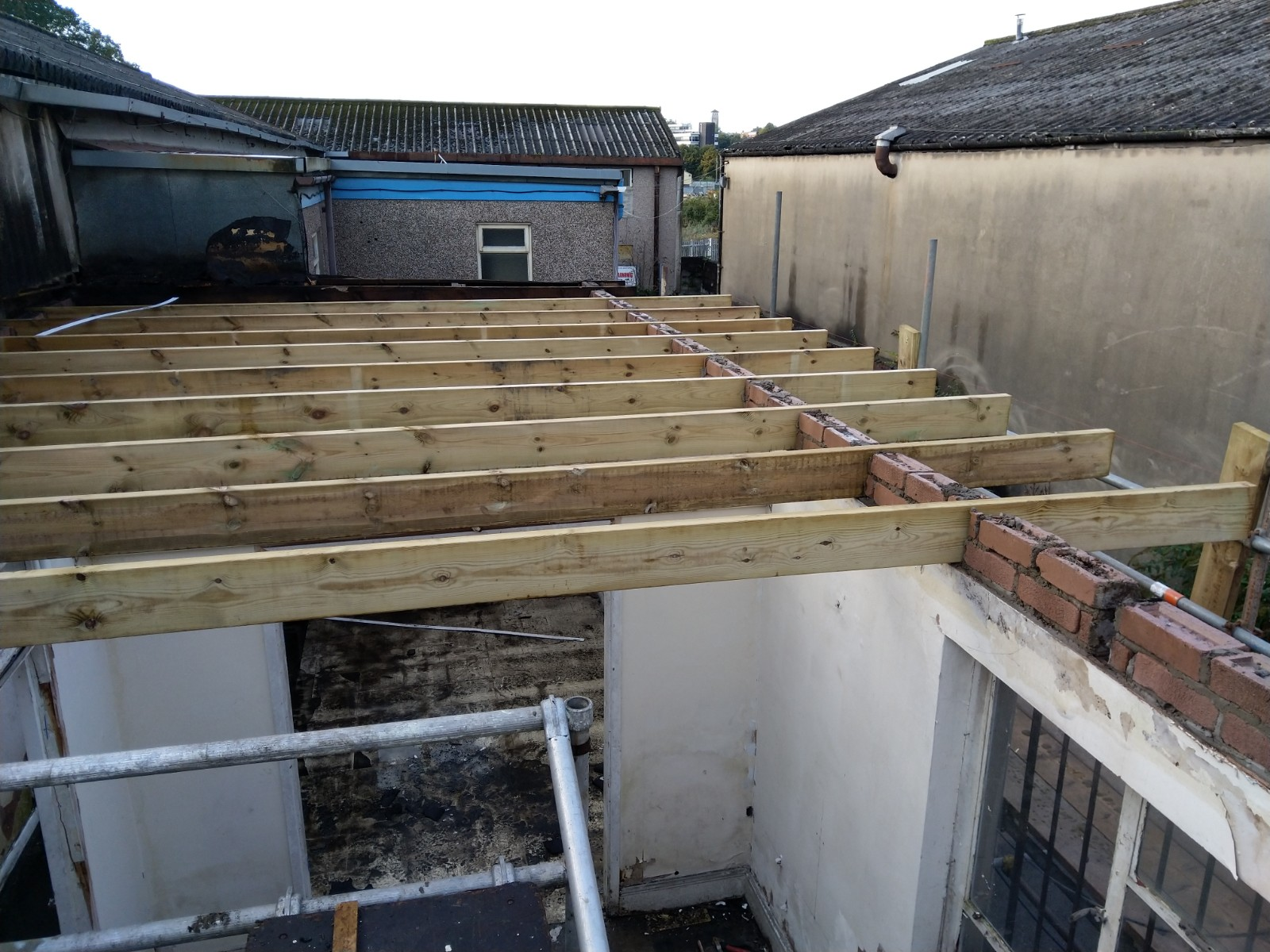 New joists for a flat roof in Newport.