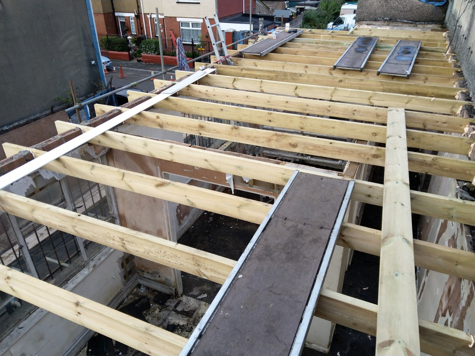 New joists fitted to old rotten flat roof.