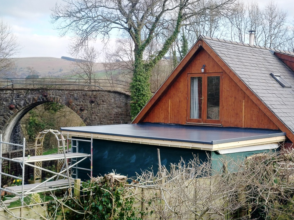 Grp flat roof near Brecon, grey topcoat.