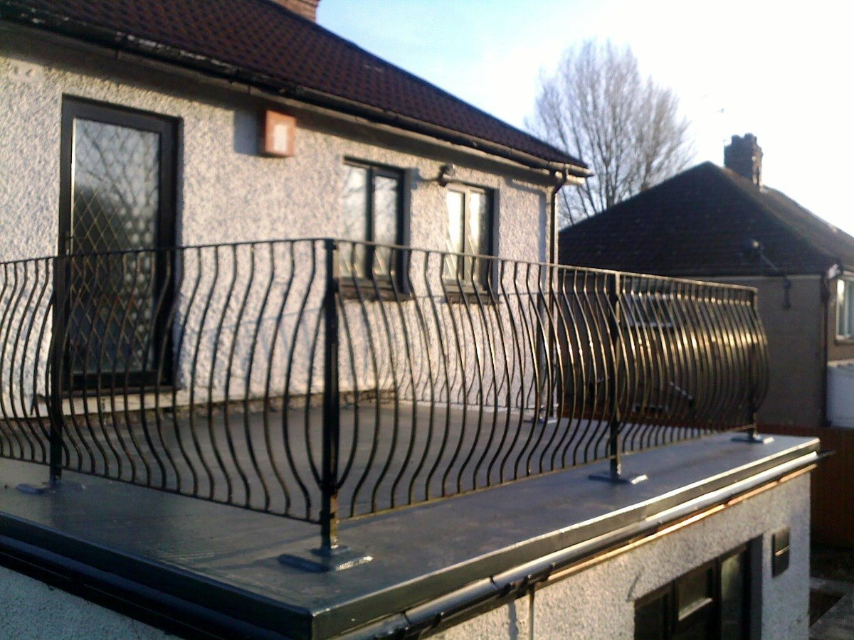 Flat roof Cardiff with railings GRP Roofing