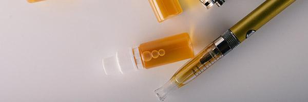 bottles of e-liquid and an e-cigarette