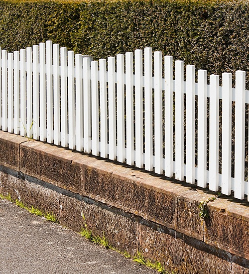 white picket fence on short wall