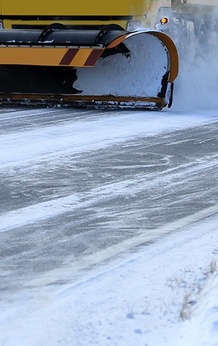 close up view of snowplough clearing snow