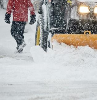 snowplough clearing a pedestrian road