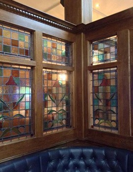 stained glass windows inside a pub