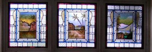 a trio of residential stained glass windows