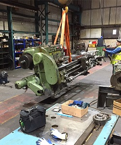 cnc machine tool part lifted by crane