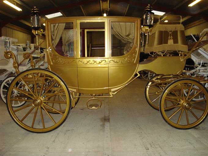 Golden Cinderella horse and carriage