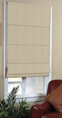 cream roman blinds in living room
