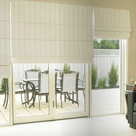 cream roman blinds on patio doors