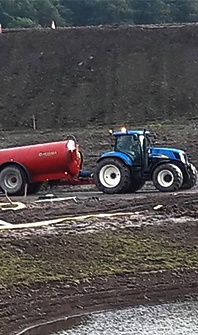 tractor with a vacuum tanker