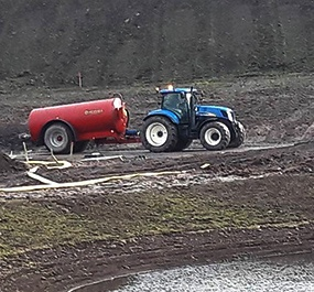 Aberdeenshire plant hire: tractor pulling a trailer in field