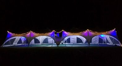 trapeze marquee light up at night