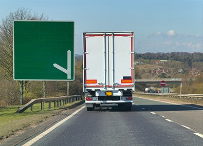 rear view of haulage lorry on motorway