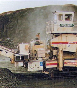 concrete crusher working on site