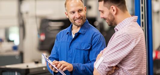 mechanic explaining mot report to customer