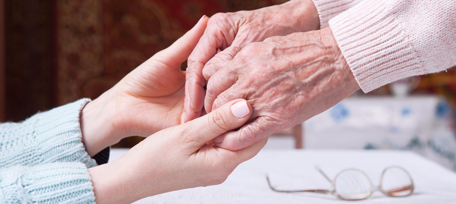 Palliative nurse helping lady