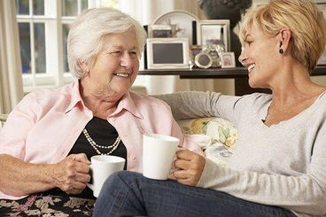 Enjoying a cup of tea with elderly lady