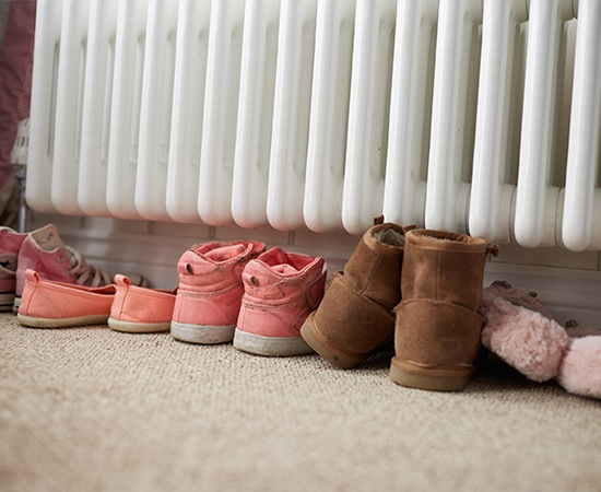 row of shoes under radiator